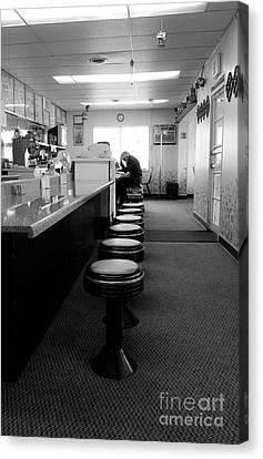 Old Diner Bar Stools Canvas Print - Alone by April DeBord