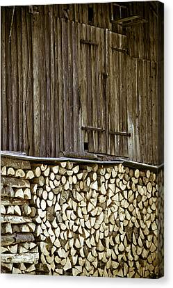 Alpine Firewood Storage Barn Canvas Print by Frank Tschakert