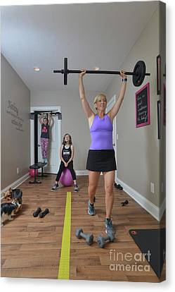 Amber Working Out At Home Canvas Print by Dan Friend