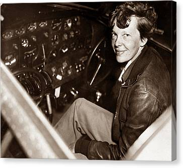 Amelia Earhart Sitting In Airplane Cockpit Canvas Print by War Is Hell Store