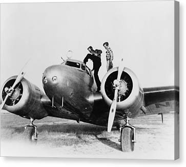 Amelia Earhart Stanind On The Wing Canvas Print by Everett