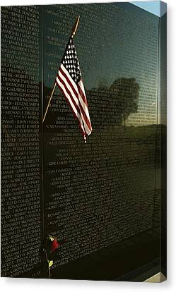 American Flag Left At The Vietnam Canvas Print