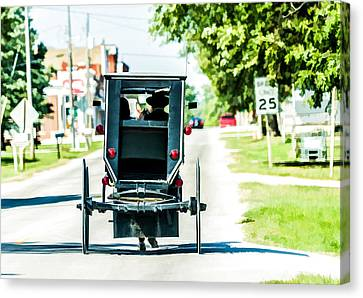 Amish Family Going To Town Canvas Print by Henry Fitzthum