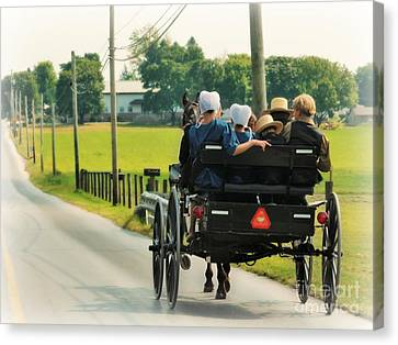 Amish Family Travelling With Horse And Buggy Canvas Print by Beth Ferris Sale