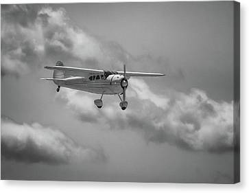 Among The Clouds Canvas Print by Guy Whiteley
