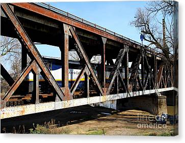 Amtrak California Crossing The Old Sacramento Southern Pacific Train Bridge . 7d11410 Canvas Print by Wingsdomain Art and Photography