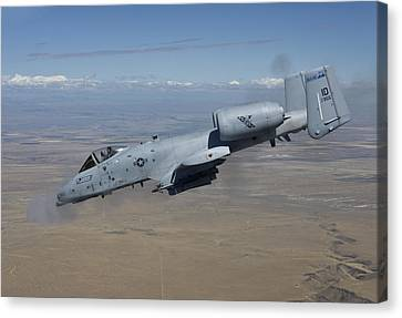 An A-10c Thunderbolt Fires Its 30mm Canvas Print by HIGH-G Productions