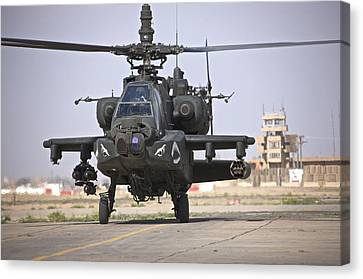 An Ah-64 Apache Helicopter Returns Canvas Print by Terry Moore