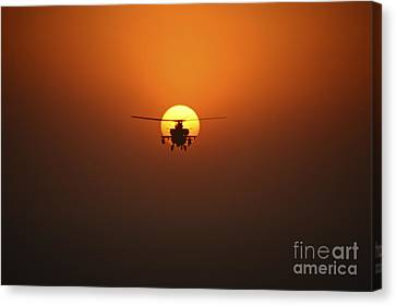 An Ah-64d Apache Helicopter Flying Canvas Print by Terry Moore
