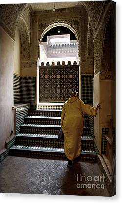 An Elderly Woman Entering The Mosque In Fes, Morocco Canvas Print by Dani Prints and Images