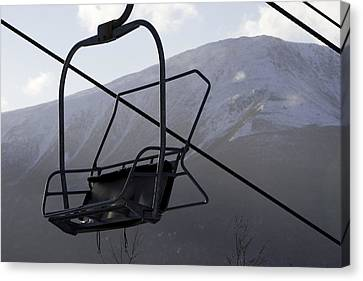 An Empty Chair Lift At A Ski Resort Canvas Print by Tim Laman