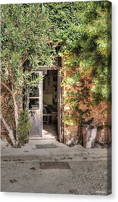 Canvas Print featuring the photograph An Entrance In Santorini by Tom Prendergast