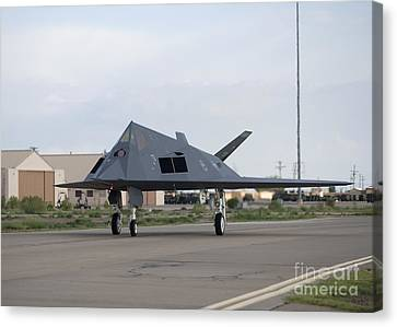 An F-117 Nighthawk Taxis To The Runway Canvas Print by HIGH-G Productions