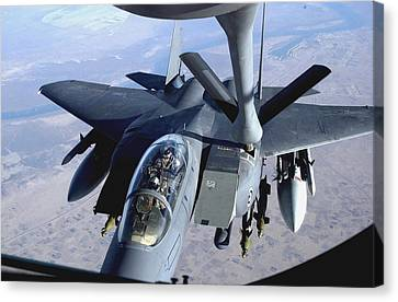 An F-15e Strike Eagle Refuels Over Iraq Canvas Print by Stocktrek Images