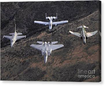 An F-16 Fighting Falcon, F-15 Eagle Canvas Print by Stocktrek Images