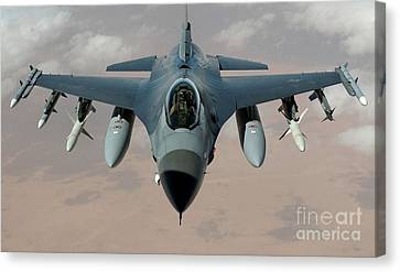 An F-16 Fighting Falcon Flies A Mission Canvas Print by Stocktrek Images