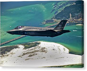 Marine Canvas Print - An F-35 Lightning II Flies Over Destin by Stocktrek Images
