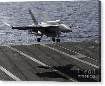 An Fa-18e Super Hornet Prepares To Land Canvas Print by Stocktrek Images