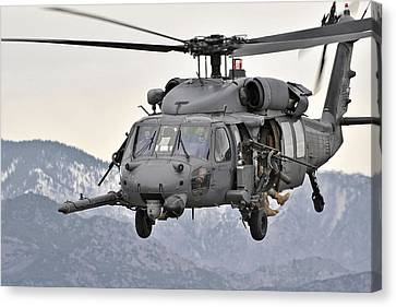 An Hh-60 Pave Hawk Helicopter In Flight Canvas Print by Stocktrek Images