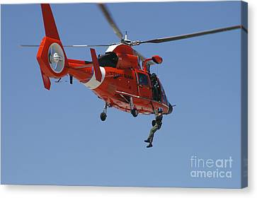 Law Enforcement Canvas Print - An Hh-65c Dolphin Demonstrates by Stocktrek Images