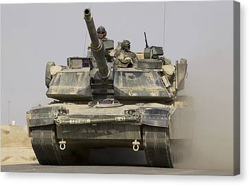 An M1a1 Abrams Tank Heading Canvas Print by Stocktrek Images
