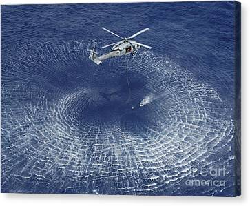 An Mh-60s Knight Hawk Prepares Canvas Print by Stocktrek Images
