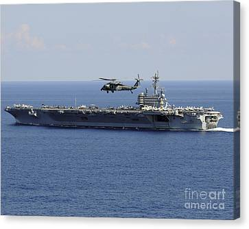 An Mh-60s Seahawk Helicopter Flies Canvas Print by Stocktrek Images