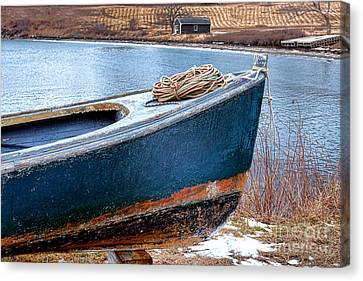 An Old Boat In Winter Canvas Print by Olivier Le Queinec