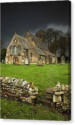Headstones Canvas Print - An Old Church Under A Dark Sky by John Short