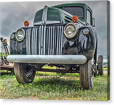 Canvas Print featuring the photograph An Old Green Ford Truck by Guy Whiteley
