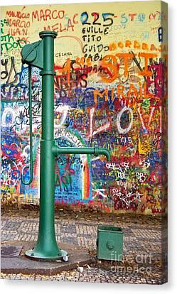 An Old Pump And Lennon Wall In Prague Canvas Print by Hideaki Sakurai
