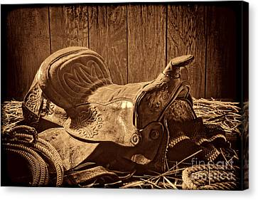 An Old Saddle Canvas Print by American West Legend By Olivier Le Queinec