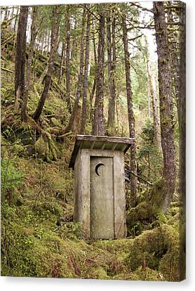 An Outhouse In A Moss Covered Forest Canvas Print by Michael Melford