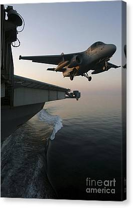 An S-3b Viking Clears The Flight Deck Canvas Print by Stocktrek Images