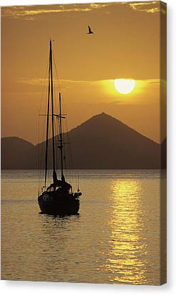 Anchored Ketch And Sunset Over Caribbean Canvas Print by Don Kreuter