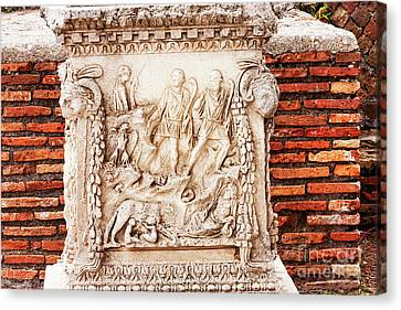 Ancient Roman Bas Relief In Ostia Antica - Italy Canvas Print by Marco Gallarino