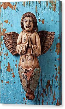 Angel On Blue Wooden Wall Canvas Print by Garry Gay