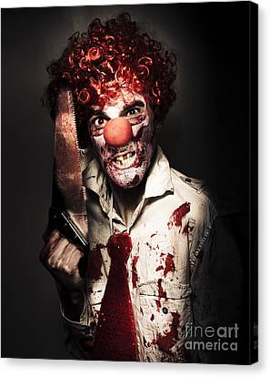 Angry Horror Clown Holding Butcher Saw In Darkness Canvas Print by Jorgo Photography - Wall Art Gallery