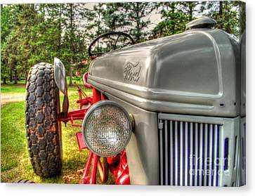 Antique Ford Tractor Canvas Print by Michael Garyet