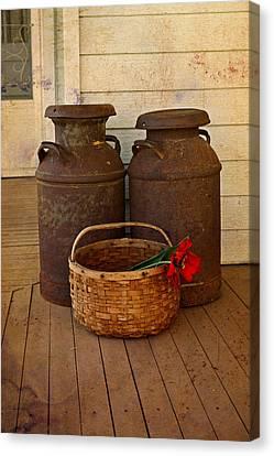 Antique Milk Cans On Porch Canvas Print by Carmen Del Valle