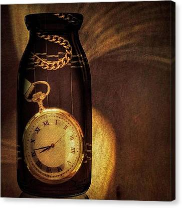 Antique Pocket Watch In A Bottle Canvas Print by Susan Candelario