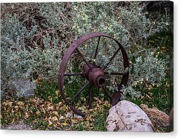 Antique Steel Wagon Wheel Canvas Print by Paul Freidlund