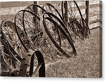 Sepia Tone Canvas Print - Antique Wagon Wheels II by Tom Mc Nemar