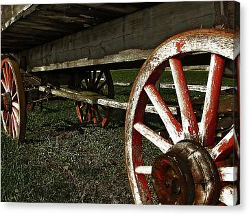 Antique Wagon Wheels Canvas Print by Scott Hovind