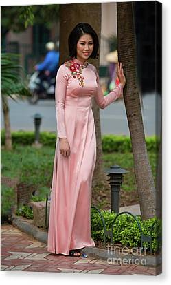 Ao Dai Fashion Hoan Kiem Lake  Canvas Print by Chuck Kuhn