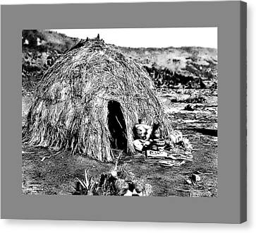 Apache Wikiup Canvas Print by John Feiser