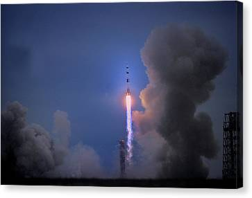 Apollo 11 Blasts Off On Mans First Canvas Print by O. Louis Mazzatenta