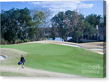 Approaching The 18th Green Canvas Print by Thomas Marchessault