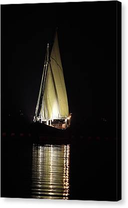 Arab Dhow At Night Canvas Print by Paul Cowan