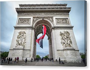 Arc De Triomphe With French Flag, Paris Canvas Print by Liesl Walsh